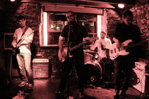 Slow Power Up performing at L'Esco, August 30 2016. From band website.